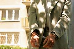 Hombre arrestado imagenes de archivo