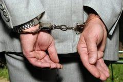 Hombre arrestado foto de archivo