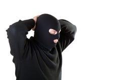 Hombre arrestado en una máscara negra. Imágenes de archivo libres de regalías