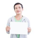 Hombre asiático con el tablero en blanco Fotografía de archivo libre de regalías