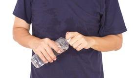 Hombre asiático con la botella de agua Fotografía de archivo libre de regalías