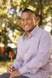 Hombre asiático con Rose Foto de archivo libre de regalías