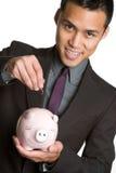 Hombre asiático de Piggybank Imágenes de archivo libres de regalías