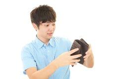 Hombre asiático decepcionado imagen de archivo