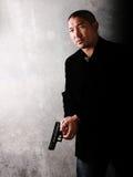 Hombre asiático del gángster imagenes de archivo