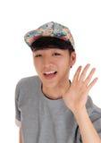 Hombre asiático feliz con el casquillo Imagen de archivo libre de regalías