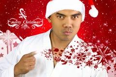 Hombre asiático hermoso con un sombrero de Papá Noel Fotografía de archivo