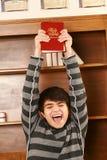 Hombre asiático joven feliz con la biblia Imágenes de archivo libres de regalías