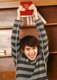 Hombre asiático joven feliz con la biblia Foto de archivo libre de regalías