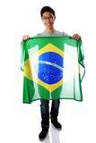 Hombre asiático joven que sostiene la bandera brasileña Imágenes de archivo libres de regalías