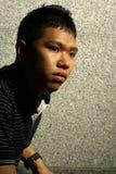 Hombre asiático que comtempla Fotografía de archivo