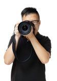 Hombre asiático que usa la cámara Imágenes de archivo libres de regalías