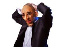 Hombre asustadizo en traje con la máscara que lleva a cabo su cabeza Imágenes de archivo libres de regalías