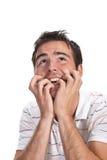 Hombre asustado con las manos en la pista Fotos de archivo libres de regalías