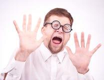 Hombre asustado en vidrios Foto de archivo libre de regalías