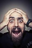 Hombre aterrorizado Imagenes de archivo