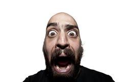 Hombre aterrorizado con una barba fotos de archivo