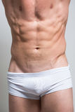 Hombre atlético que muestra el ABS del cuerpo muscular y del sixpack Imagen de archivo