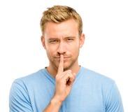 Hombre atractivo con el finger en los labios Fotografía de archivo
