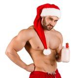 Hombre atractivo de la Navidad que presenta en la cámara aislada en un fondo blanco Fotos de archivo libres de regalías