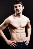 Hombre atractivo descamisado con el abdomen muscular Fotos de archivo libres de regalías