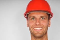 Hombre atractivo en un casco protector Imágenes de archivo libres de regalías