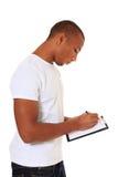 Hombre atractivo que toma notas Fotografía de archivo libre de regalías