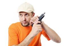 Hombre barbudo con un arma Imágenes de archivo libres de regalías