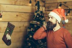 Hombre barbudo de la Navidad en guantes Imagenes de archivo