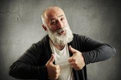 Hombre barbudo de risa que muestra los pulgares para arriba Fotografía de archivo libre de regalías