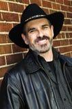 Hombre barbudo en sombrero de vaquero Imagen de archivo libre de regalías