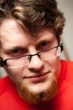 Hombre barbudo en vidrios Imagen de archivo libre de regalías