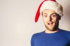 Hombre barbudo hermoso, Año Nuevo, fondo de la Navidad Foto de archivo