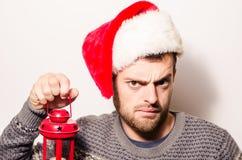 Hombre barbudo hermoso, Año Nuevo, fondo de la Navidad Foto de archivo libre de regalías
