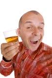Hombre borracho que sostiene un vidrio de whisky Foto de archivo
