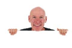 Hombre calvo con la tarjeta blanca Fotos de archivo libres de regalías