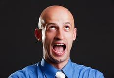 Hombre calvo de griterío Foto de archivo libre de regalías