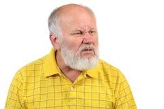 Hombre calvo del mayor asqueado Foto de archivo libre de regalías