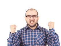Hombre calvo enojado en vidrios Imagen de archivo libre de regalías