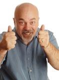 Hombre calvo que da los pulgares para arriba Foto de archivo libre de regalías