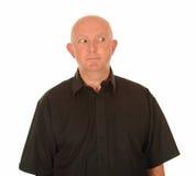 Hombre calvo que mira a la cara Fotos de archivo libres de regalías