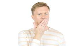 Hombre cansado joven que bosteza, fondo blanco Imágenes de archivo libres de regalías