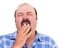 Hombre cansado que bosteza Imagen de archivo