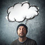 Hombre casual con la nube rhinking del baloon Imagen de archivo libre de regalías