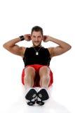 Hombre caucásico atractivo, ejercicios abdominales Fotos de archivo libres de regalías