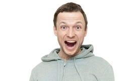 Hombre caucásico joven feliz en chaqueta de deportes gris Imagen de archivo libre de regalías