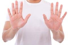 Hombre caucásico joven que siembra su palma de las manos Foto de archivo libre de regalías