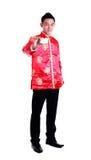 Hombre chino asiático que sostiene el papel de la tarjeta a mano, Año Nuevo chino encendido Imagen de archivo libre de regalías