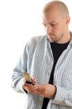 Hombre con celular Imagen de archivo