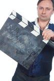 Hombre con clapperboard Imagen de archivo libre de regalías